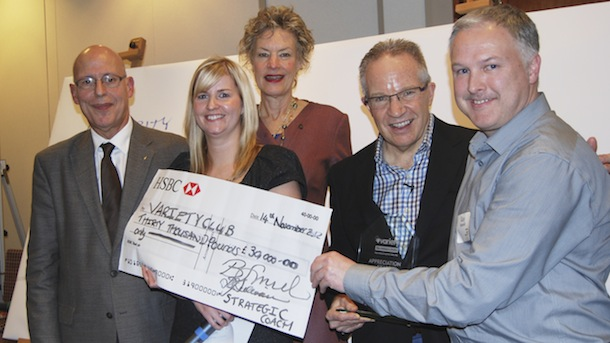 Andrea Dempsey, Babs Smith, and Dan Sullivan of Strategic Coach present a cheque to Variety Village U.K. for £30,000.
